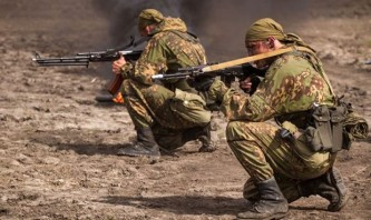 Российские военные с улыбками на лице возвращаются на Родину из Сирии